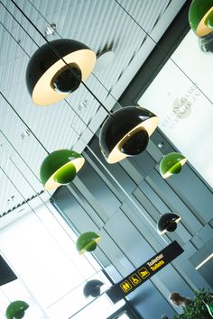 These Verner Panton Flower Pots light up the Carlsberg Bar in CPH. We love the combination of green and black colors and the soft light.
