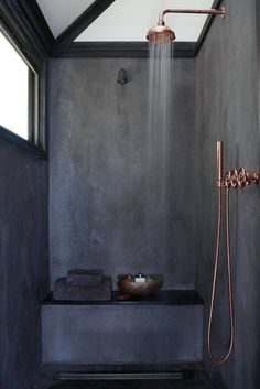 This dark shower with copper accents that still has plenty of light.