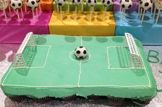 Pullapart Cupcake cake made with 24 cupcakes to look like soccer field. Soccer ball cake pop in the centre.