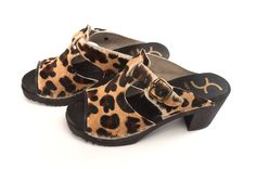Cougar Clog - Find your inner cougar self! This is a classy, open-toe sandal made from real leopard hair material. Black painted bottoms with a 2 1/2-inch heel, with stapled construction. A leather binding in the front has been added to the construction of the upper material. Runs in Ladies' sizes 35-41. Product Code 4002018. View here: http://capeclogs.com/our-clogs/picapica-high-heels/cougar.