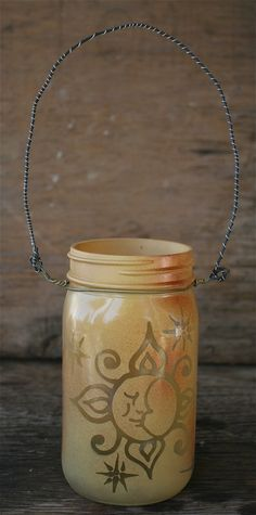 Hey, I found this really awesome Etsy listing at http://www.etsy.com/listing/115640195/mason-jar-lantern-sun-and-moon-face-with