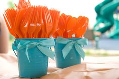 This image was largely responsible for my entire theme! The turquoise pails were in the dollar bins at Target and I ordered the orange utensils from Oriental Trading - more bang for my buck. For Nemo theme party.