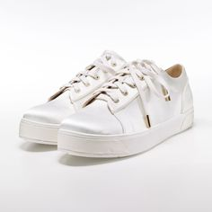 Wedding trainers? These ivory satin Florence 'Kristen' trainers are all sorts of cool. We love.