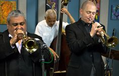 Trumpeters Ray Vega (East Coast) and Thomas Marriott (West Coast) have joined forces once again for the newest edition of their East-West Trumpet Summit with pianist George Colligan, bassist Phil Sparks and drummer Matt Jorgensen.