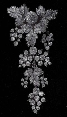 The devant-de-corsage of the 'parure de groseillier' (currant leaf parure) of the French Crown Jewels was made in 1855 by Bapst for Empress Eugénie, wife of Napoleon III.