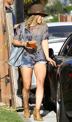 Seen on Celebrity Style Guide: Actress Hilary Duff stops by a friends house wearing this sheer stripe top and floral cut off shorts in Hollywood, California on May 14....  Get Her Top Here: http://rstyle.me/n/fus9cmxbn