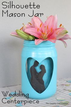 Silhouette Mason Jar for Weddings -- add a great kissing couple silhouette to a mason jar for a fun wedding centerpiece that your guests will remember!