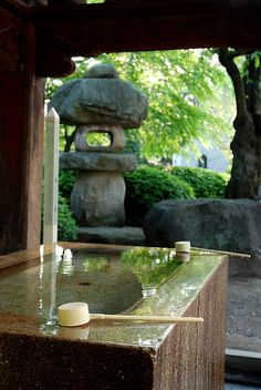 "Purification fountains can be found everywhere in modern Japan, including private gardens, homes, and businesses. At all Shinto shrines, worshippers and casual visitors are asked to purify themselves (Harai ) of impurity before praying to the Shinto deities. The act of cleansing is called Misogi, and the actual washing of hands and mouth with water is called Temizu. An associated term is Imi, meaning ""abstention from defilement."" Most large shrines have a stone wash basin where worshippers…"