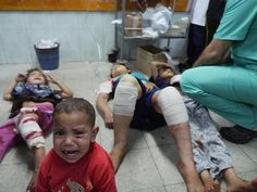 Israel bombs UN school in Gaza killing women and children. The United Nations Relief and Works Agency (UNRWA) has confirmed that at least four Israeli shells struck one of its schools in Gaza, killing at least 17 people and injuring more than 200. July, 2014.