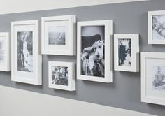 Mix and match frames to create a feature on your walls. These light wooden frames look great with bright prints behind them.