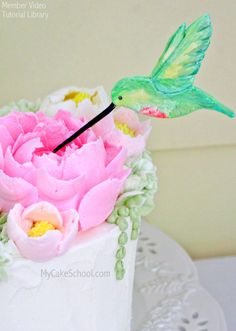 Hummingbird Topper Cake Tutorial with Fluffy Frosting Flowers!  by MyCakeSchool.com