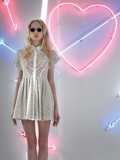 neon heart reflects the shape on the dress - love this minimalist slash 80s glam mix