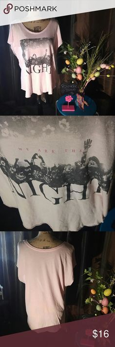 AE brand size XL pink T-shirt American Eagle brand size XL graphic t-shirt in the beautiful color pink cap cut off sleeves. The front is written in Black and dark pink writing with flowers and hands up at a concert it says we are the night. Beautiful t-shirt ready to sell only worn a few times like new condition no low-ball offers considered no trades American Eagle Outfitters Tops Tees - Short Sleeve