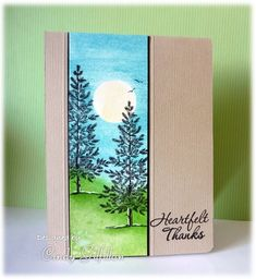 "Lovely as a Tree (frenziedstamper at Splitcoaststampers). Mask the moon. Sponge sky & grass. Spritz with water then dab quickly with tissue to lift off some of the ink. Temove mask & stamp trees (from Stampin' Up's ""Lovely as a Tree"".) Use white gel pen for highlights. Draw birds in sky. Mount on black panel, then on kraft card base. Score down length of panel, both sides."
