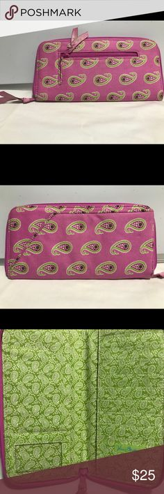 """🤶🏼 Vera Bradley Travel Wallet I love this style wallet!!!! Retired Bermuda Pink 1/05-7/07   Bifold, zip closure, interior has ID window, passport slip, 2 Bill slots, 9 card slots. 9.5 x 5"""". Please review all pictures prior to purchase   If you have questions I'm happy to respond!! All Vera purchases are recorded in order to ensure a fair and equitable transaction for the buyer and seller. 🤗🤗 Vera Bradley Bags Wallets"""