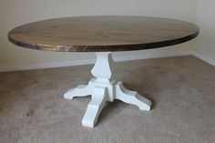 60 inch round, solid-wood farmhouse table with pedestal base in dark walnut stain and ivory paint