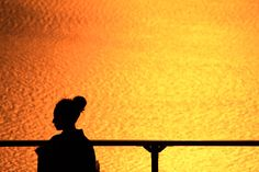 """A sunset and woman"" by Hiroshi Oka"