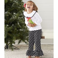 2-piece set. Cotton top with dimensional tree applique has pom pom trimmed collar ruffle and coordinating spandex flare polka dot pants.