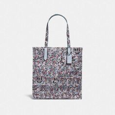 bac643710b6a This canvas tote features works from artist Keith Haring, combining his  iconic illustrations with Coach's signature craft and prairie florals.