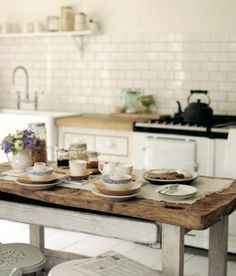"husband calls this kind of table ""splinter furniture"", but i call it perfect- particularly in this kitchen www.agastoves.co.za"