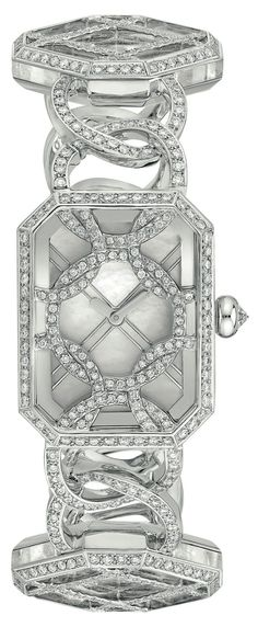 Chanel Fine Jewelry Collection in 18K white gold set with Brilliant Cut Diamonds and carved rock crystal.