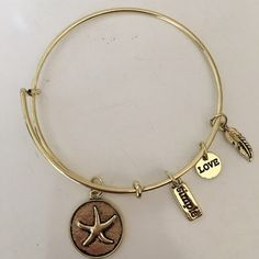 NWOT  GOLD STARFISH BANGLE BRACELET NWOT This fun and fashionable gold starfish bangle bracelet is perfect for any Spring and Summer fashion. The hottest item of the season. Can be stacked or worn alone you have the freedom to choose xoxo Wrist Candy Jewelry Bracelets