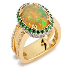 Interlude 150-R34 Ethiopian Opal, resting over Black Diamonds, set in 22ct gold surrounded with Tsavorite Garnets and Diamonds set in 18ct Gold and platinum