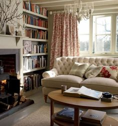 Maybe new curtains, but love the room, books, fireplace and sofa... and colors...Laura Ashley living room.
