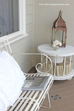 Porch table made from a repurposed cable spool.  Awesome ! (from The Vintage Dormer)