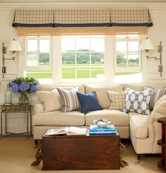 Neutral walls, slipcovered furniture, and blue accents