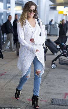 Kool lady: Khloe looked stunning but kept her outfit casual as she arrived at JFK airport earlier in the day