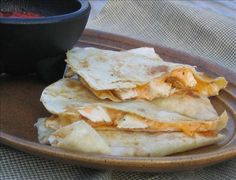 Just like Taco Bell's Chicken Quesadillas...I made these all summer for the boys! I make a container full of the sauce recipe and store it in the fridge for future use. I also buy bags of Tyson's frozen already cooked grilled chicken strips. Super easy!
