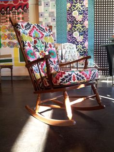Vintage rocker revived in rainbow floral fabric.
