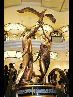 HARRODS STATUE    photo   Dodi Al Fayed, Princess Diana - former Harrods owner Mohamed Al Fayed, in 2005, whose son Dodi died in the fatal crash alongside Diana in 1997, unveiled an 8-ft. tall statue of Diana and Dodi in his London store.