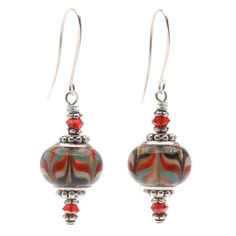 These richly textured earrings will look beautiful hanging from your ear. The focal bead is a large-hole Pandora style bead which is accented by Swarovski crystal bicones. Easy to make, yet scrumptious to