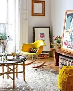 leave pictures sitting on the floor. Sitting a piece of art on top of a stack of books (or is that a stack of decorative boxes?) makes it look less than accidental. Also in this photo: lean a piece of art on a bench or hall table for a more casual look.