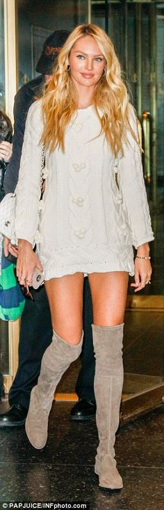 Dressed up: The model stunned in a beige sweater-dress with matching thigh-high boots...
