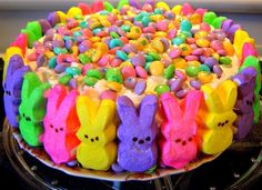 This doesn't seem to lead to a specific recipe, but it looks simple enough: a one-layer cake with Peeps pressed into the frosting on the side, and M sprinkled on top (I guess you could use colored sugar instead of M if you want).  Super cute but wow that's a ton of sugar!