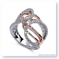 An 18K white and rose gold dress ring with a split shank design culminating in two gregarious loops of pav-set diamonds. Snuggled beneath their nurturing embrace lie a demure pair of 18K rose gold ribbons that create a warm high polish contrast.
