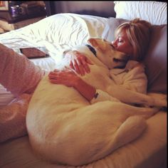 Snuggle buddies...this looks like something both my labs would do