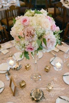 #BlushPink and ivory tall centerpieces using a crystal prism bowl candelabra using Quicksand roses, pink O'Hara garden roses, hydrangea, Vendela roses, gypsophila, seeded eucalyptus and spray roses. Designed by #CreativeWeddingsFloralDesigns (Photo courtesy of #PeakPhotography) #FairmontBanffSpringsWedding #BanffWeddingFlorist #BanffBride #CalgaryWeddingFlorist #weddingflowers
