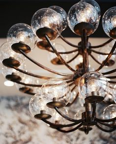 Lonny's online photo archives... like decor picture heaven {Midcentury Photo - A vintage glass-and-brass chandelier}