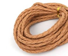 View a large assortment of wholesale 3mm round braided leather cords wholesale usa in different colors and sizes.