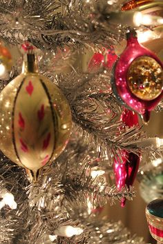 Vintage Christmas Ornaments. I always loved the elongated egg-shaped ones that came to a point like the one on the left.