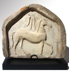 Greek terracotta antefix relief with horse, 4th century B.C. South Italian. Private collection