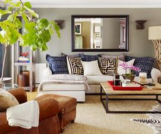 Mix and match patterned pillows on your sofa to add dimension to your space. Tour the rest of this colorful, pattern-filled home makeover: http://www.bhg.com/decorating/decorating-style/modern/do-it-yourself-eclectic-makeover/?socsrc=bhgpin053113pillows=2