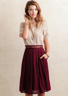 Create an endless amount of adorable ensembles with this burgundy-hued skirt crafted in a lightweight material that provides a flowy midi silhouette. Box pleating adorns the waistline for added...