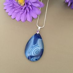 Blue and White Swirled Agate Pendant Necklace. Offered by HappyLilac