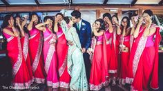 Lovely portrait of bride and groom with bridesmaids.