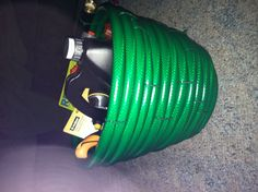 House warming gift ... Basket made out of a garden hose, filled with lawn care items :)